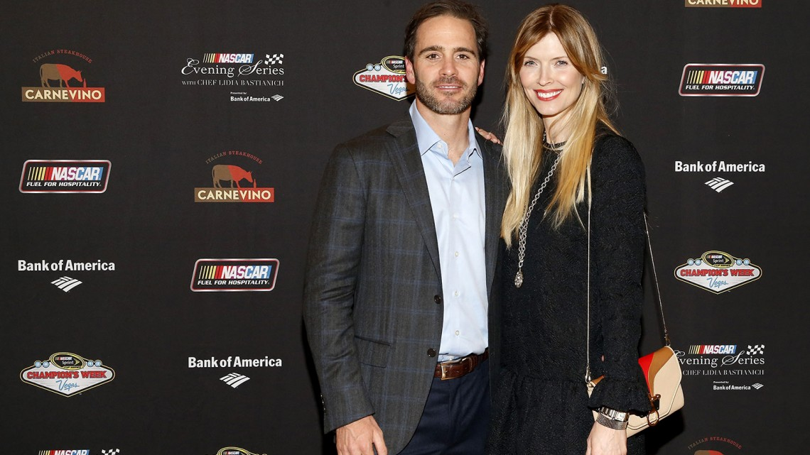 NASCAR Sprint Cup series champion Jimmie Johnson and wife Chandra Johnson pose for a picture at the NASCAR Evening Series Presented by Bank of America at Carnevino at The Palazzo Las Vegas on December 4, 2013 in Las Vegas, Nevada.