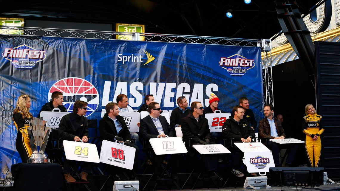 (Back L-R) Carl Edwards, Kasey Kahne, Ryan Newman, Kurt Busch, Greg Biffle, Joey Logano, Clint Bowyer, (Front L-R) Jeff Gordon, Dale Earnhardt Jr., Kyle Busch, Kevin Harvick, Matt Kenseth, and 2013 NASCAR Sprint Cup Champion Jimmie Johnson attend a fanfest hosted by Las Vegas Motor Speedway on the Third Street Stage at the Fremont Street Experience on December 4, 2013 in Las Vegas, Nevada. (Credit: NASCAR via Getty Images)