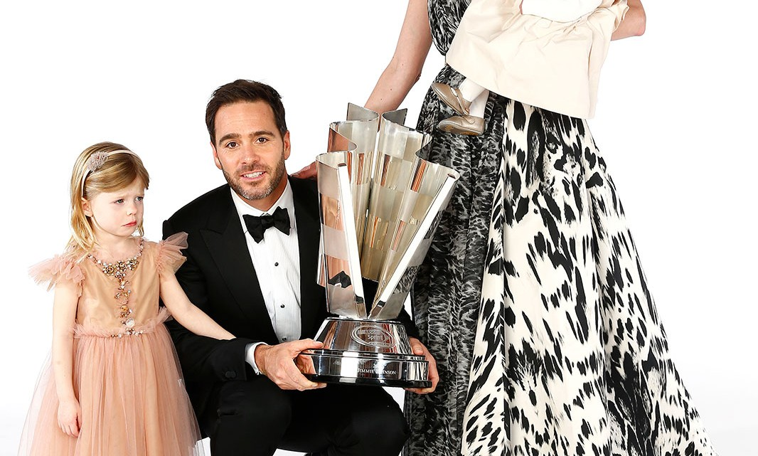 NASCAR Sprint Cup Series Champion Jimmie Johnson, his wife Chandra, daughters Genevieve Marie and Lydia Norriss pose for a portrait prior to the NASCAR Sprint Cup Series Champion's Awards at Wynn Las Vegas on December 6, 2013 in Las Vegas, Nevada. (Credit: Chris Graythen/NASCAR via Getty Images)