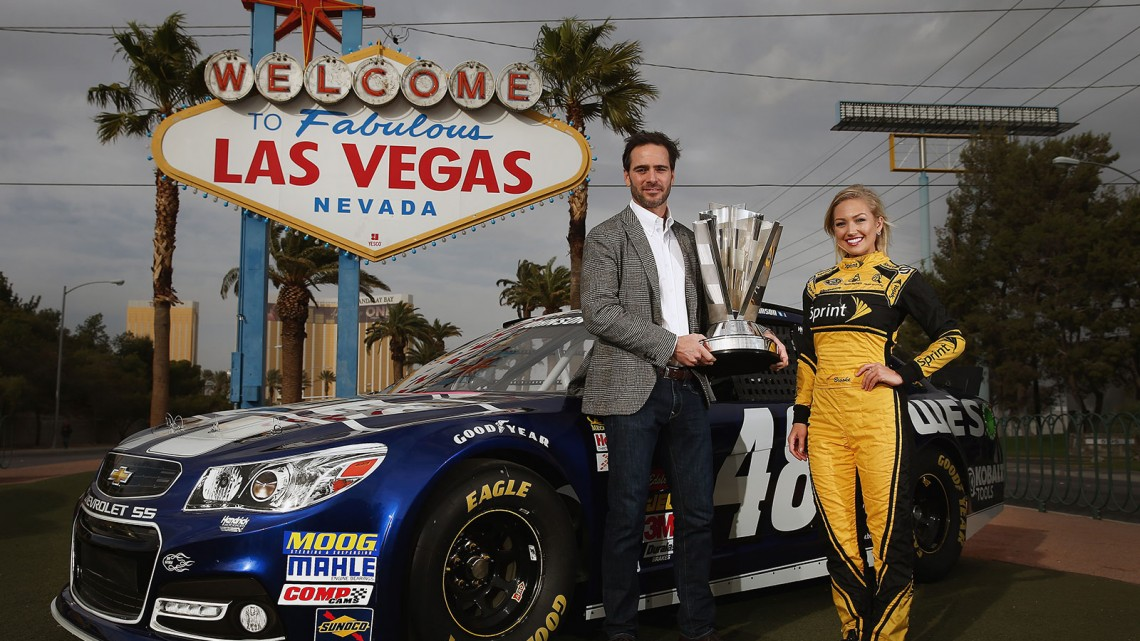 NASCAR Sprint Cup Champion Jimmie Johnson, driver of the #48 Lowe's Chevrolet and Miss Sprint Cup Brooke Werner pose for a photo at the 'Welcome to Fabulous Las Vegas' sign on December 3, 2013 in Las Vegas, Nevada. Johnson is in Las Vegas for a week of 2013 NASCAR Sprint Cup Championship activities. (Credit: NASCAR via Tom Pennington/Getty Images)