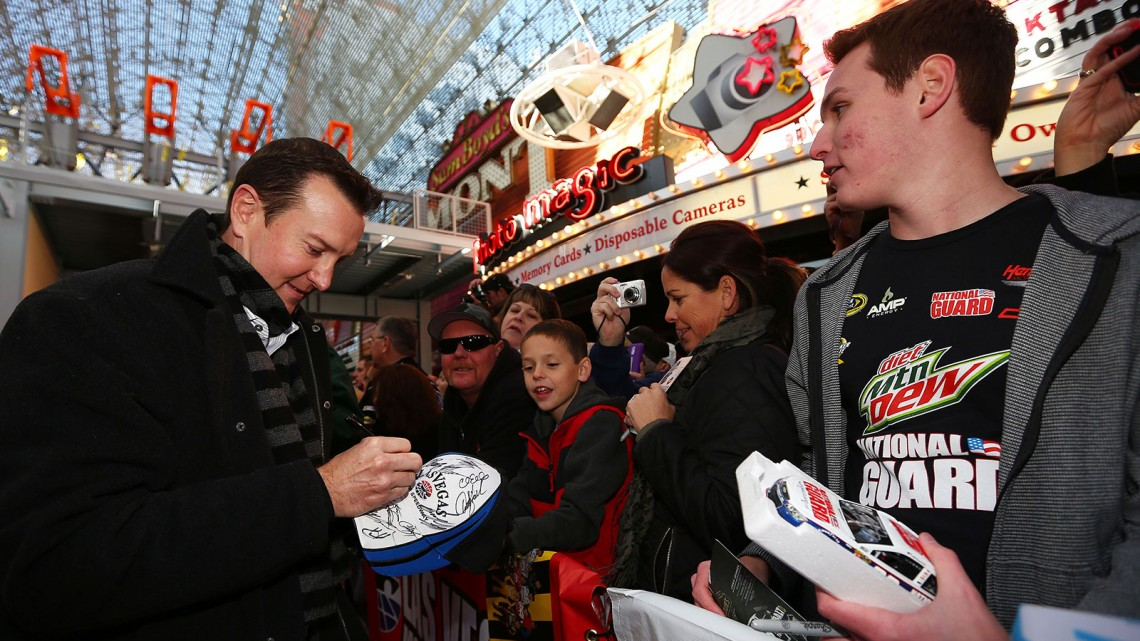 NASCAR Sprint Cup Series driver Kurt Busch signs autographs at a fanfest hosted by Las Vegas Motor Speedway on the Third Street Stage at the Fremont Street Experience on December 4, 2013 in Las Vegas, Nevada. (Credit: NASCAR via Getty Images)