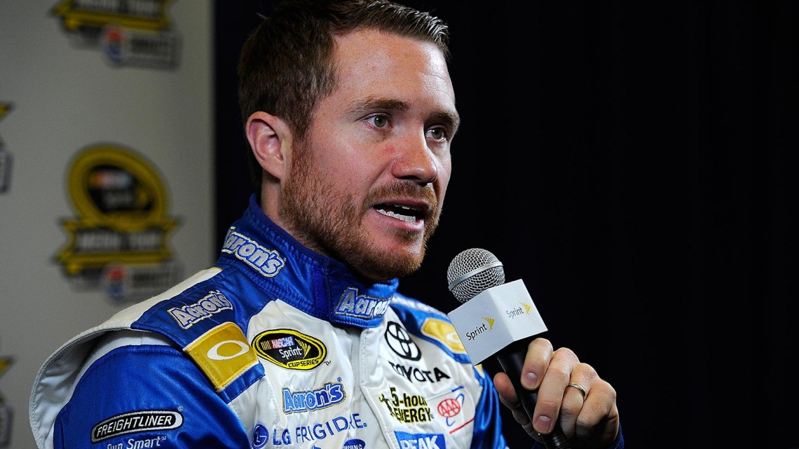 Brian Vickers, driver of the #55 Aaron's Dream Machine Toyota, speaks with the media during NASCAR Sprint Media Tour at Charlotte Convention Center on January 30, 2014 in Charlotte, North Carolina. (Credit: Jared C. Tilton/Getty Images)