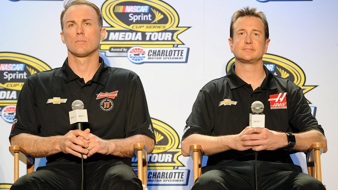 Kevin Harvick (left), driver of the #4 Budweiser/Jimmy John's Chevrolet, and Kurt Busch, driver of the #41 Haas Racing Chevrolet, look on during NASCAR Sprint Media Tour at Charlotte Convention Center on January 27, 2014 in Charlotte, North Carolina. (Credit: Jared C. Tilton/Getty Images)