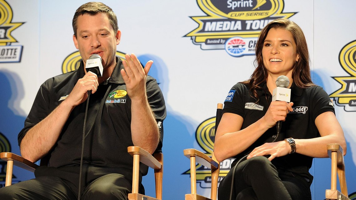 Tony Stewart (left), co-owner of Stewart-Haas Racing and driver of the #14 Bass Pro Shops Chevrolet, and Danica Patrick, driver of the #10 GoDaddy.com Chevrolet, speak with the media during NASCAR Sprint Media Tour at Charlotte Convention Center on January 27, 2014 in Charlotte, North Carolina. (Credit: Jared C. Tilton/Getty Images)