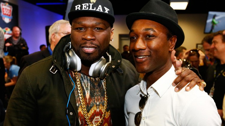 Curtis '50 Cent' Jackson poses with singer Aloe Blacc before the NASCAR Sprint Cup Series Daytona 500 at Daytona International Speedway on February 23, 2014 in Daytona Beach, Florida. (Credit: Jonathan Ferrey/NASCAR via Getty Images)