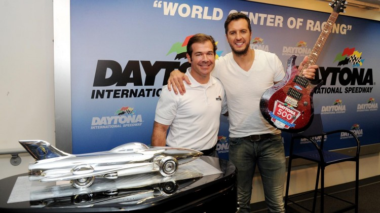 Singer Luke Bryan poses with Joie Chitwood III, president of Daytona International Speedway, and the Harley J. Earl Trophy before the NASCAR Sprint Cup Series Daytona 500 at Daytona International Speedway on February 23, 2014 in Daytona Beach, Florida. (Credit: Patrick Smith/Getty Images)