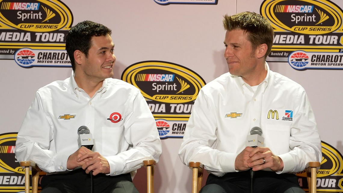 Kyle Larson (left), driver of the #42 Target Chevrolet, and Jamie McMurray (right), driver of the #1 McDonalds/Cessna Chevrolet, speak with the media during the NASCAR Sprint Media Tour at Charlotte Convention Center on January 28, 2014 in Charlotte, N.C. (Credit: Grant Halverson/Getty Images)