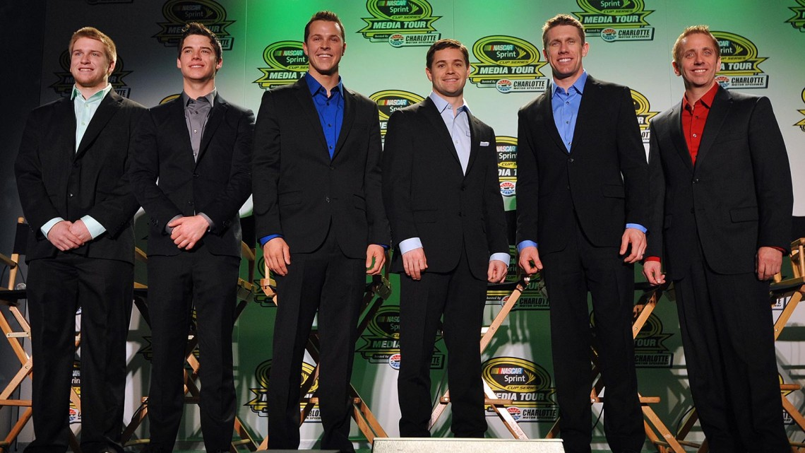 (L-R) Chris Buescher, driver of the No. 60 Ford EcoBoost Ford, Ryan Reed, driver of the No. 16 American Diabetes Drive to Stop Diabetes presented by Lilly Diabetes Ford, Trevor Bayne, driver of the No. 6 Advocare Ford, Ricky Stenhouse Jr., driver of the No. 17 Nationwide Ford, Carl Edwards, driver of the No. 99 Fastenal Ford, and Greg Biffle, driver of the No. 16 3M Ford, pose for the media during the NASCAR Sprint Media Tour at Charlotte Convention Center on January 29, 2014 in Charlotte, North Carolina. (Credit: Rainier Ehrhardt/Getty Images)