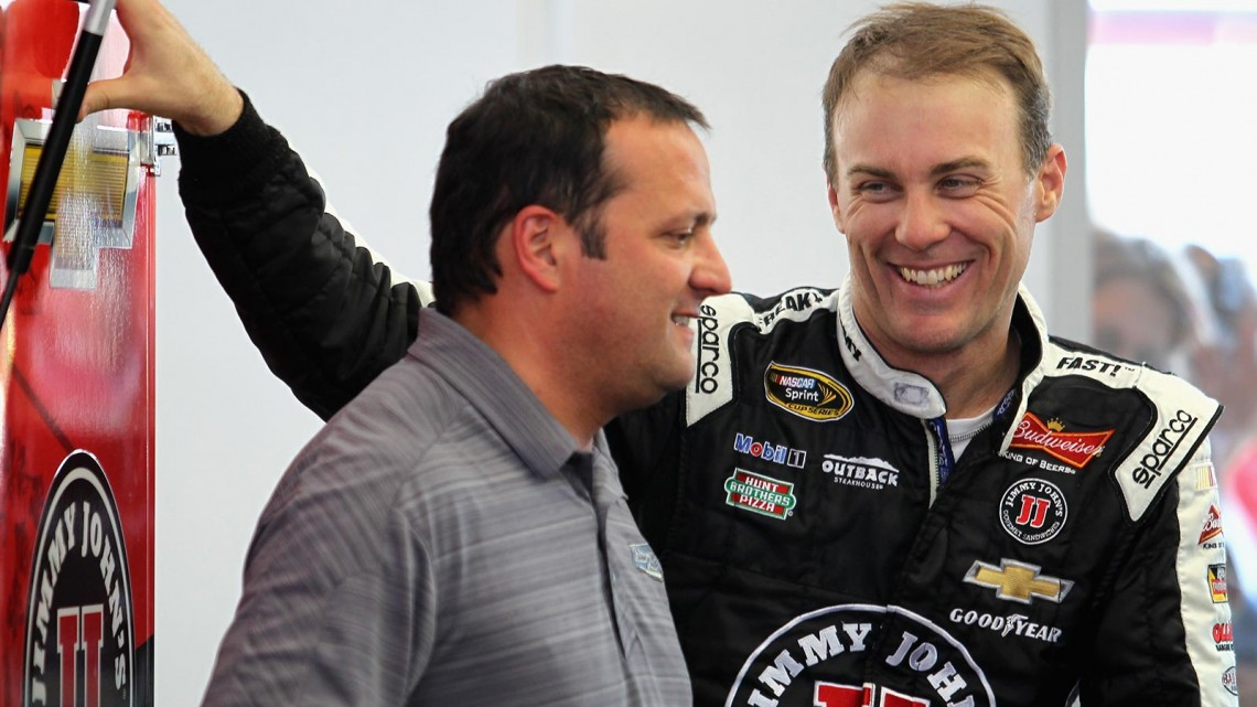 (L-R) Stewart-Haas Racing competition director Greg Zipadelli talks to Kevin Harvick, driver of the #4 Jimmie John's Chevrolet, in the garage during a testing session at Las Vegas Motor Speedway on March 6, 2014 in Las Vegas, Nevada. (Credit: 295914Todd Warshaw/NASCAR via Getty Images)
