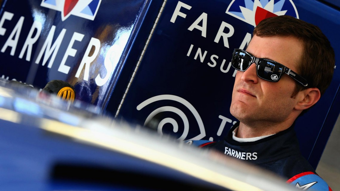 Kasey Kahne, driver of the #5 Farmers Insurance Chevrolet, stands in the garage area during practice for the NASCAR Sprint Cup Series Kobalt 400 at Las Vegas Motor Speedway on March 8, 2014 in Las Vegas, Nevada. (Credit: 295946Sean Gardner/NASCAR via Getty Images)
