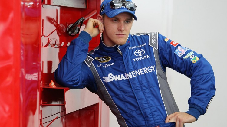 Parker Kligerman, driver of the #30 Aria Hotels/Black Clover Toyota, stands in the garage during a testing session at Las Vegas Motor Speedway on March 6, 2014 in Las Vegas, Nevada. (Credit: 295901Todd Warshaw/NASCAR via Getty Images)