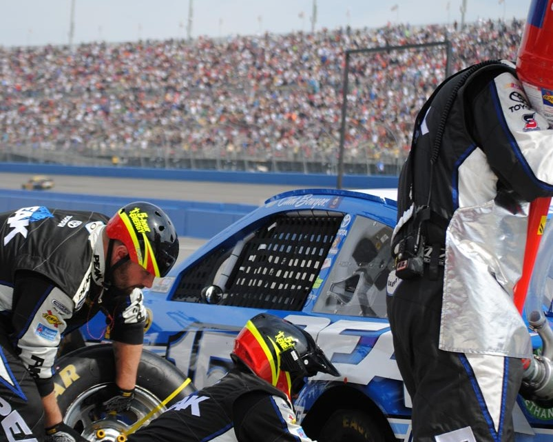 The No . 15 pit crew in action.  (Photo Credit: Heather Baker/The Fast and the Fabulous)