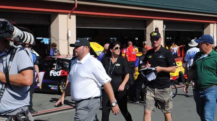 Clint Bowyer walks through the garage at Sonoma Raceway on Friday, June 20, 2014. (photo credit: Heather Baker/The Fast and the Fabulous)