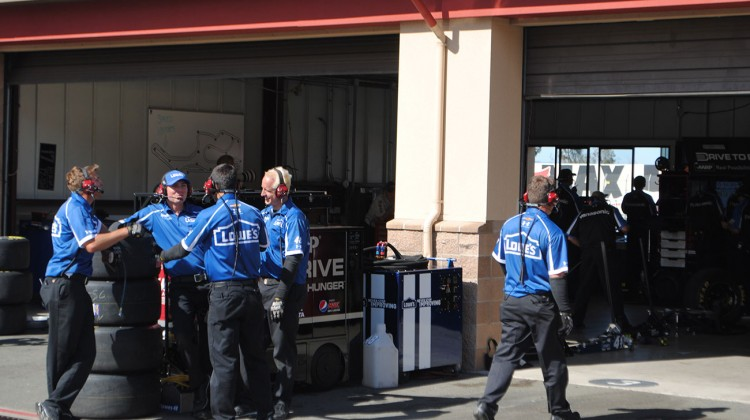 The No. 48 team chats while waiting for their driver to come in from practice at Sonoma Raceway on Friday, June 20, 2014. (photo credit: Heather Baker/The Fast and the Fabulous)