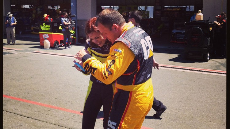 Ryan Newman looks at a photo Miss Sprint Cup took of him in the garage at Sonoma Raceway on Friday, June 20, 2014. (photo credit: The Fast and the Fabulous)