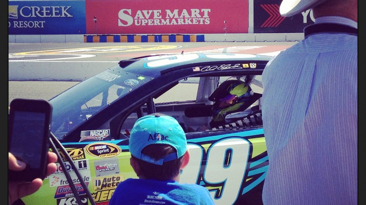 Carl Edwards (and a young fan! too cute) during qualifying at Sonoma Raceway on Saturday, June 21, 2014. (photo credit: The Fast and the Fabulous)