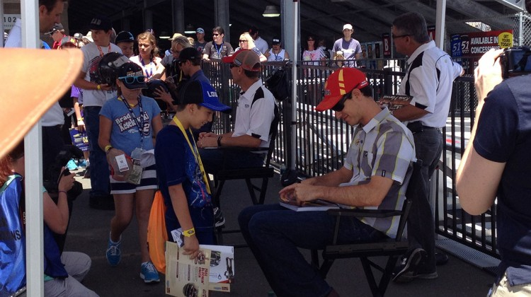 Joey Logano signing for kids at Sonoma Raceway on Saturday, June 21, 2014. (photo credit: The Fast and the Fabulous)