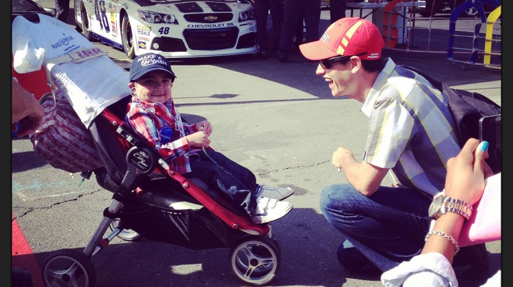 Joey Logano meets a young fan at Sonoma Raceway on Saturday, June 21, 2014. (photo credit: The Fast and the Fabulous)