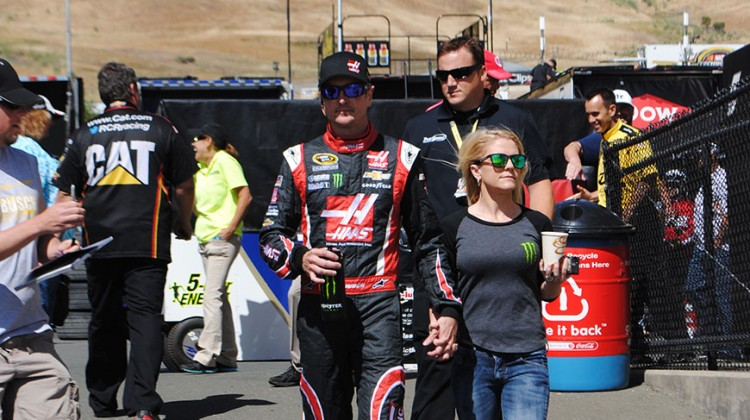 Kurt Busch walks with his girlfriend, Patricia Driscoll, to qualifying at Sonoma Raceway on Saturday, June 21, 2014. (photo credit: Heather Baker/The Fast and the Fabulous)