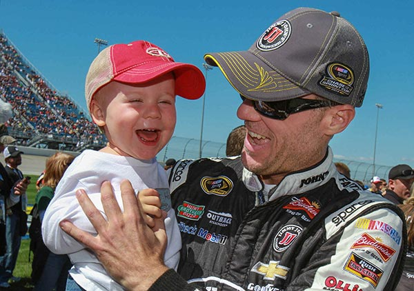 Kevin Harvick, driver of the #4 Budweiser Chevrolet SS with his son, Keelan, before the race. Harvick finished in fifth place Sunday, September 14, 2014 in the Chase Challenger 16 NASCAR Sprint Cup race at Chicagoland Speedway in Joliet, Illinois. Harvick is in the Chase which begins with the Challenger 16 for this race and the following two. (Photo by Alan Marler/HHP for Chevy Racing)
