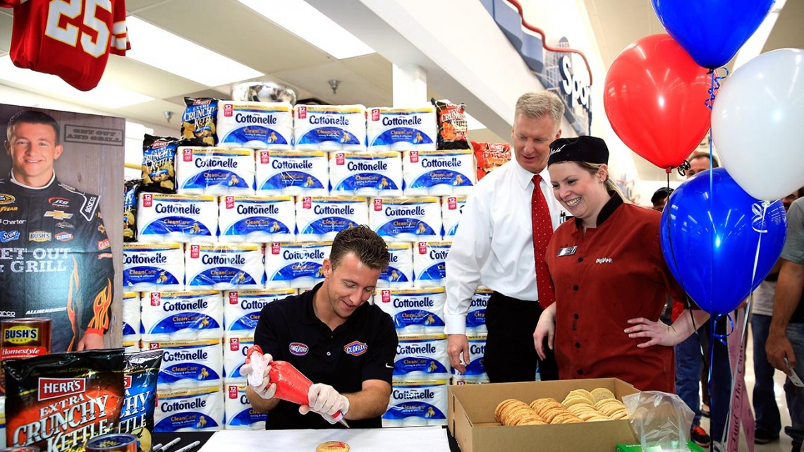 NASCAR Chase Driver AJ Allmendinger decorates cookies while making a Chase Across North America appearance on behalf of Kansas Speedway at a Hy-Vee grocery store on September 10, 2014 in Shawnee, Kansas. (Credit: Jamie Squire/Getty Images for Kansas Speedway)