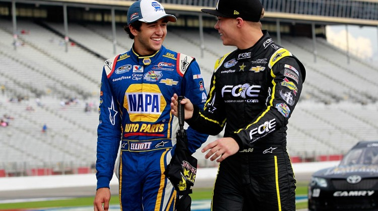 Chase Elliott (L), driver of the #9 NAPA AUTO PARTS Chevrolet, talks with Dylan Kwasniewski, driver of the #31 FOE Chevrolet, on the grid during qualifying for the NASCAR Nationwide Series Great Clips 300 at Atlanta Motor Speedway on August 30, 2014 in Hampton, Georgia. (Credit: 301010Brian Lawdermilk/NASCAR via Getty Images)