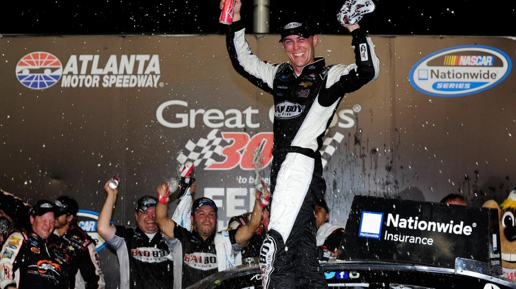 Kevin Harvick, driver of the #5 Bad Boy Buggies Chevrolet, celebrates in Victory Lane after winning the NASCAR Nationwide Series Great Clips 300 at Atlanta Motor Speedway on August 30, 2014 in Hampton, Georgia. (Credit: 301023Jeff Curry/Getty Images)