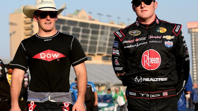 Austin Dillon (L), driver of the #3 Dow Chevrolet, walks with Ty Dillon, driver of the #33 Realtree Chevrolet, on the grid during qualifying for the NASCAR Sprint Cup Series Oral-B USA 500 at Atlanta Motor Speedway on August 29, 2014 in Hampton, Georgia. (Credit: 301004Brian Lawdermilk/NASCAR via Getty Images)