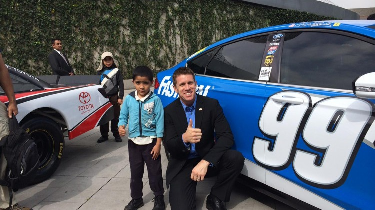 Carl Edwards, driver of the No. 99 Fastenal Ford, visits with a fan in Mexico City during a Chase Across North America visit on September 10, 2014. (Credit: NASCAR)
