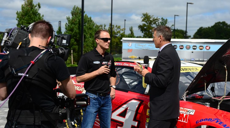 Kevin Harvick, driver of the No. 4 Jimmy John's Chevrolet, speaks with anchor Jay Crawford outside the ESPN studios during a SportsCenter segment in Bristol, Connecticut as part of the Chase Across North America on September 10, 2014. (Credit: Joe Faraoni / ESPN Images)