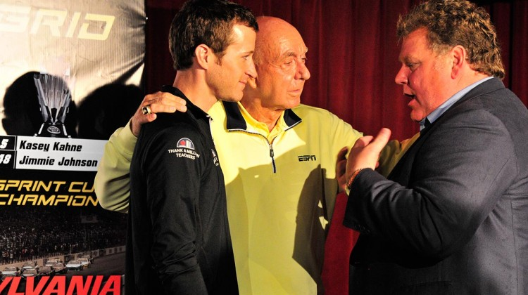 (L-R) Kasey Kahne, basketball broadcasting legend Dick Vitale and Jerry Gappens, general manager of New Hampshire Motor Speedway talk at a Chase Across North America event at the Hard Rock Cafe in Boston on behalf of New Hampshire Motor Speedway on September 10, 2014. (Credit: Alan MacRae/New Hampshire Motor Speedway)