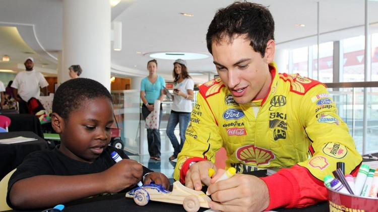 Joey Logano, driver of the No. 22 Shell Pennzoil Ford, meets with children during a Chase Across North America event at Children's Hospital of Alabama at the University of Alabama Birmingham on September 10, 2014. (Credit: Talladega Superspeedway)