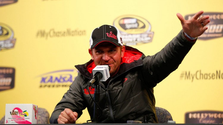 Clint Bowyer, driver of the #15 Pink Lemonade 5-hour ENERGY Benefitting LBBC Toyota, speaks at a press conference prior to practice for the NASCAR Sprint Cup Series Hollywood Casino 400 at Kansas Speedway on October 3, 2014 in Kansas City, Kansas. (Credit: Matt Sullivan/NASCAR via Getty Images)