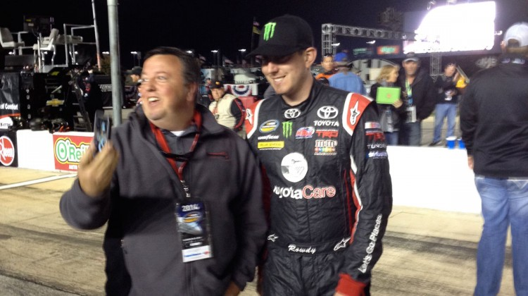 Kyle Busch taking a picture with a fan at Texas Motor Speedway. (photo credit: The Fast and the Fabulous)