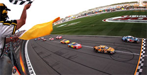 Greg Biffle crosses the finish line to win at Kansas Speedway. (Photo Credit: Jamie Squire / Getty Images)