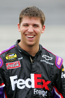 Denny Hamlin is all smiles during qualifying for the Subway 500 at Martinsville Speedway (Photo Credit: Streeter Lecka/Getty Images)