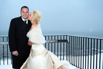 Cortney and Johnny steal a sweet moment together with Lake Michigan in the background