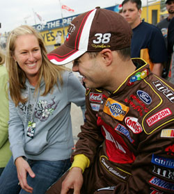 David Gilliland (right) and wife Michelle are all smiles at Daytona International Speedway where Gilliland won the pole for the Daytona 500 in February of 2007. (Photo Credit: Jonathan Ferrey/Getty Images for NASCAR
