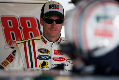 Dale Earnhardt Jr. waits for NASCAR Sprint Cup Series practice to get under way at Darlington Raceway (Photo Credit: Chris Graythen / Getty Images)