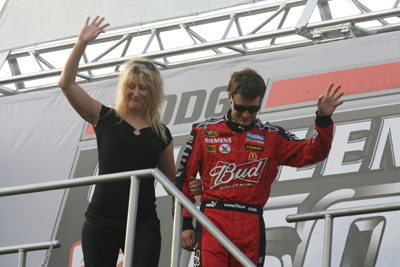 Tammy Kahne and her son Kasey wave to the Darlington Raceway crowd before the Dodge Challenger 500 (Photo Credit: Jerry Markland/Getty Images for NASCAR)
