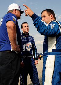 (Left to right) Crew chief Pat Tryson and Penske Racing teammates Kurt Busch and Ryan Newman debrief after NASCAR Sprint Cup Series practice at Darlington Raceway for the Dodge Challenger 500 (Photo Credit: Rusty Jarrett/Getty Images for NASCAR)
