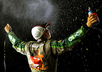 After winning the Dodge Challenger 500 NASCAR Sprint Cup Series event at Darlington Raceway, Kyle Busch gets doused by the No. 18 team in victory lane (Photo Credit: Jason Smith/Getty Images for NASCAR)