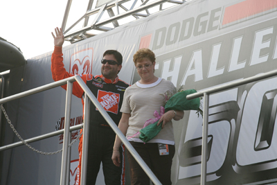 Tony Stewart and his mother, Pam Boas, wave to the Darlington Raceway crowd during driver introductions for the Dodge Challenger 500 (Photo Credit: Jerry Markland/Getty Images for NASCAR)