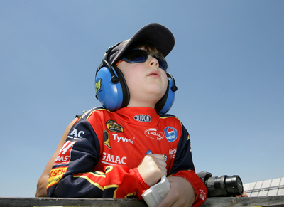 One of Jeff Gordon's youngest fans, Jaden Greenbaum of Philadelphia, watches the No. 24 during NASCAR Sprint Cup Series practice on Friday (Photo Credit: Drew Hallowell / Getty Images for NASCAR)