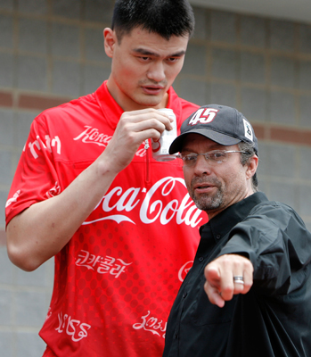 Yao Ming (L) talks with Kyle Petty (R) prior to the NASCAR Sprint Cup Series Coca-Cola 600 on May 25, 2008 at Lowe's Motor Speedway in Concord, North Carolina. (Photo by Streeter Lecka/Getty Images)