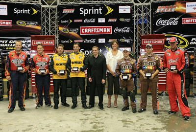 (L-R): Individual winners Caleb Hurd, gas man for the No. 24 Dupont Chevrolet, Jamie Frady, catch can man for the No. 24 Dupont Chevrolet, Dave Smith, rear tire changer for the No. 17 DeWalt Ford, Jason Binger, rear tire carrier for the No. 17 DeWalt Ford, Nick O'Dell, front tire changer for the No. 18 M&M's Toyota, Brad Donaghy, front tire carrier for the No. 18 M&M's Toyota and Eric Wilson, jackman for the No. 9 Budweiser Dodge pose in Victory Lane. (Photo Credit: Jerry Markland/Getty Images for NASCAR)