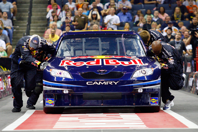The No. 83 Red Bull Toyota pit crew of Brian Vickers pushes their car towards the finish line during the Craftsman 40-Yard Push. The crew won the championship, setting a new speed record along the way. (Photo Credit: John Harrelson/Getty Images for NASCAR)