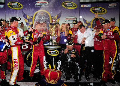 Clint Bowyer and his team celebrate winning the Crown Royal Presents The Dan Lowry 400 at Richmond International Raceway. (Photo Credit: Rusty Jarrett/Getty Images for NASCAR)