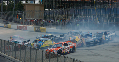 A 10-car crash brought out the first caution of the Best Buy 400 Benefiting Student Clubs for Autism Speaks NASCAR Sprint Cup Series race at Dover International Speedway. The race red-flagged for 16 minutes and 13 seconds to clean up the track. (Photo Credit: Nick Laham/Getty Images)