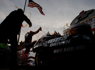 Denny Hamlin celebrates his second victory and fifth top-10 finish in seven races at Dover International Speedway. (Photo Credit: Nick Laham/Getty Images)